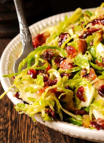 Brussels Sprouts and Cranberry salad on a white plate