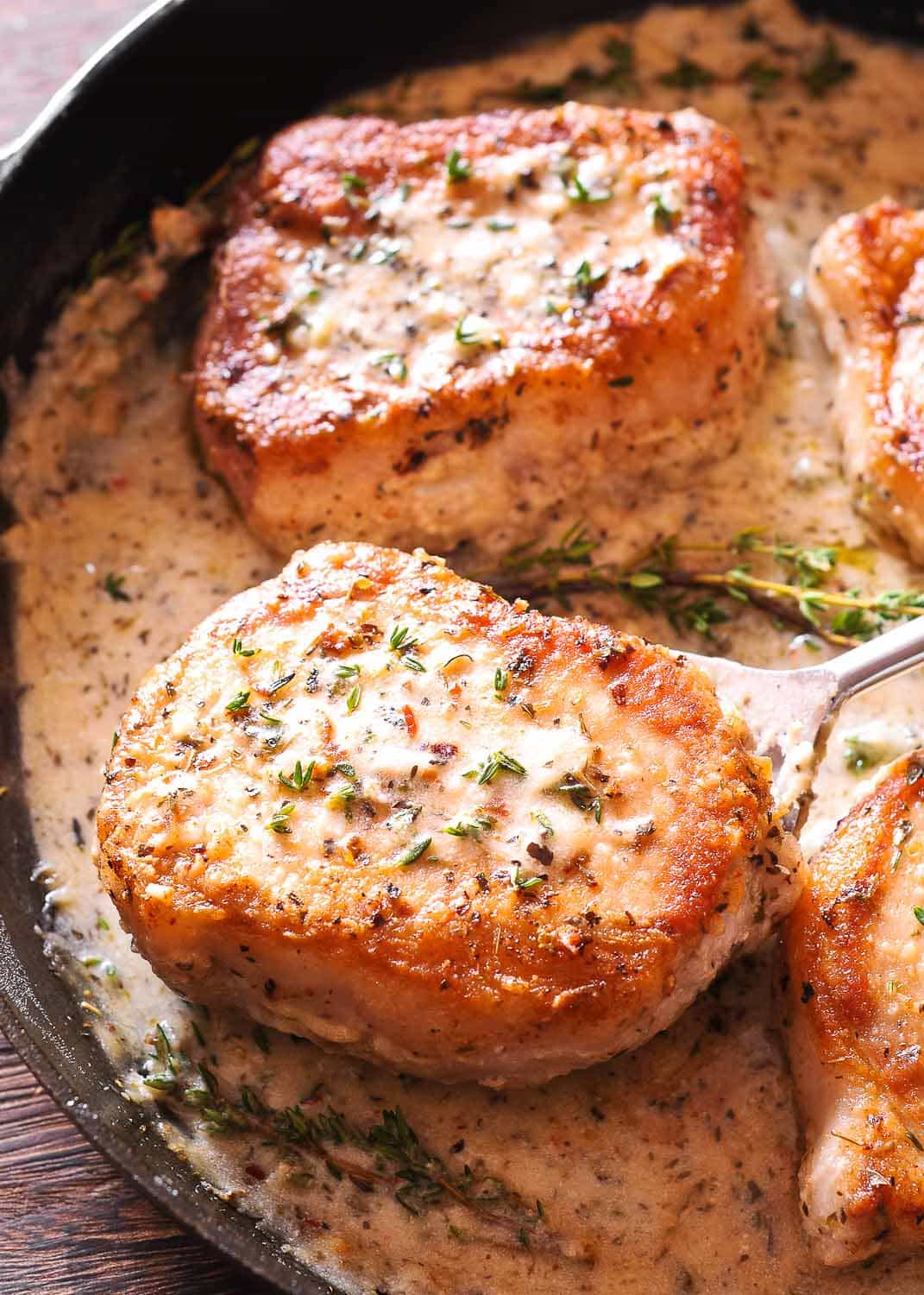 Boneless Pork Chops in Creamy Garlic and Herb Wine Sauce
