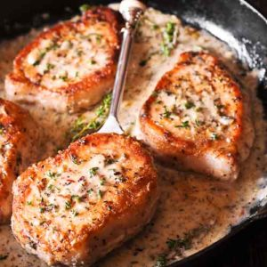 Boneless Pork Chops in Creamy Herb and Wine Sauce