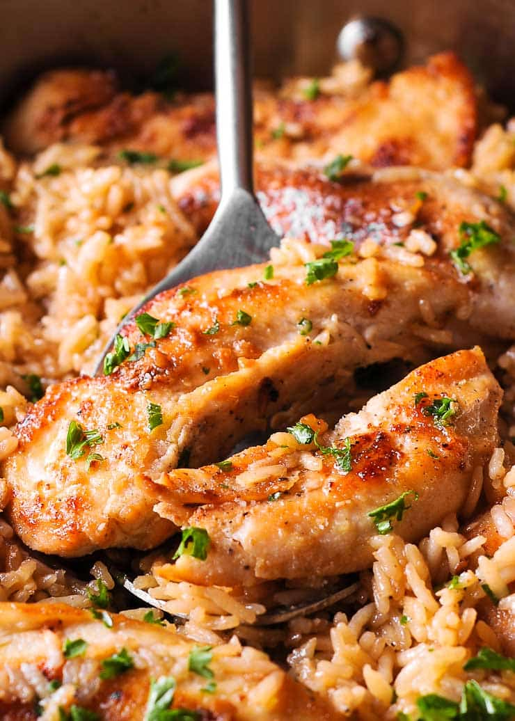 Chicken with Garlic Parmesan Rice is the perfect dish for easy weeknight dinners. This quick chicken and rice recipe is not only tasty but it uses ingredients you likely have on hand!
